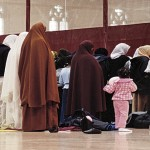 Somali women pray during an Id al-Fitr service in the Gray Athletic Building