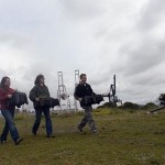 From left, Jen Stankiewicz '02, Carla Hoag White '68 and Michael Martin, volunteer membership coordinator for the Golden Gate Audubon Society, carry crates of native species for planting at the Pier 94 wetland site.