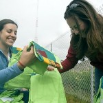 Aliza Luft '06 and Jen Stankiewicz ' 02 choose their National Day of Service T-shirts.