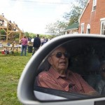 Ayers' grandparents, Gus and Marion Ayers of Waterbury, Vt., watch from their vehicle.