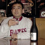 "Tokyo, 10:47 p.m.   FOR GOODNESS SAKE Kimmochi Eguchi '97 relaxes at home with a drink of Hana Ginga sake. ""'Hana' means elegance,"" says Eguchi. ""'Ginga' is a mintage of two words, 'galaxy' and 'taste.' Shuffling the words, it becomes 'elegance of taste like galaxy.' That's the idea anyway!"""