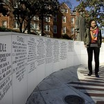 Mbali Ndlovu gazes around the monument, which includes a donor-recognition wall. At far left, Bates College and trustee Bruce Stangle '70 are noted.