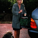 Santa Barbara, Calif. 6:47 a.m.   GRAPE EXPECTATIONS Vice president for public relations and marketing for the Fess Parker Winery and Vineyard, Ashley Parker Snider '86 prepares to leave for a meeting in Los Angeles with her distributor. Tim Snider, her husband, photographed Ashley and their dog, Molasses.