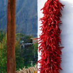 Red peppers and corn offer color as mountains provide the rugged backdrop in Zhong Lu, a rural Tibetan village in Danba county in Sichuan province. Photo by Margaret Maurer-Fazio.
