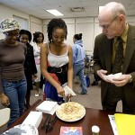 After class, Ndlovu helps serve a Spanish frittata prepared by her professor, Frederick Langhorst, an associate professor of world languages and literature. Celebrating a birthday, he brought the dish to class.