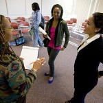 From left, Associate Professor of Women's Studies M. Bahati Kuumba, Ndlovu and D'Oyen talk after their class in the Camille Olivia Hanks Cosby Academic Center.