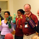 "A ""Mario"" puppet play, made famous by the late Professor of English John Tagliabue, is performed by (from left) Thomas Wesson '09, Donna Rampersad '08, Shawna-Kaye Lester '08, vice president Bill Hiss '66, and College chaplain Bill Blaine-Wallace. Directing the play is Paul Hoffman '58 (not pictured)."