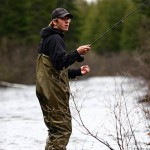 Christopher Morrell '08 of Brunswick, Maine, wades and fishes in the inlet of West Branch Pond.