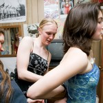 Amelia Hagen-Dillon '08 (left) and Aubrey Nelson '08 (center) help Emily Hopkins '08 into her dress.