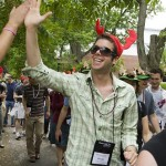 Brent Jarkowski '03 gives a high-five along the parade route.