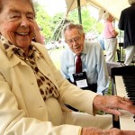 Following the Alumni Association meeting, Doris Neilson Whipple '34 tickled the ivories as Al Webber '28 listens.