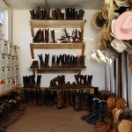Hats, boots and ropes line the walls of an outbuilding at the Laramie River Dude Ranch. Photograph by Shauna Stephenson.