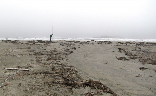 This seaward-looking view of the beginning of the new channel across the sand spit was taken on April 7, 2009. Note how the seaweed, wood and other debris have been cleared from the area of fastest flow. Photograph by Mike Retelle.