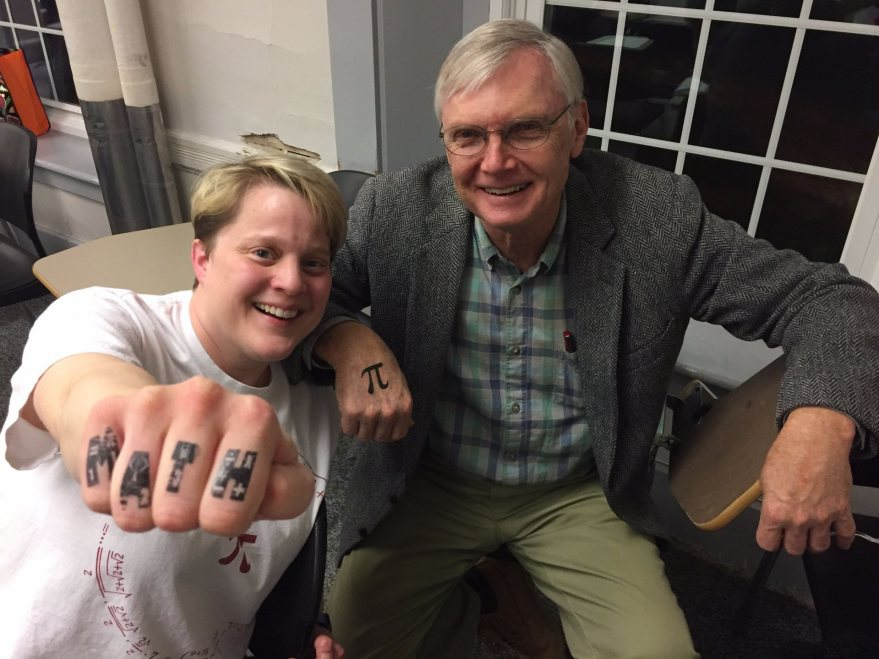 Math department members Grace Coulombe and Scott Balcomb sport Pi Day Celebration tatoos