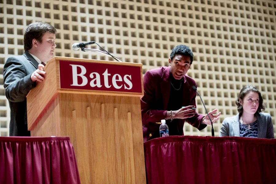 During the Benjamin Mays Debate, Harry Meadows '19 listens as Zachary Manuel of Morehouse College offers a point of information. At right is Abby Westberry '19. (Phyllis Graber Jensen/Bates College)