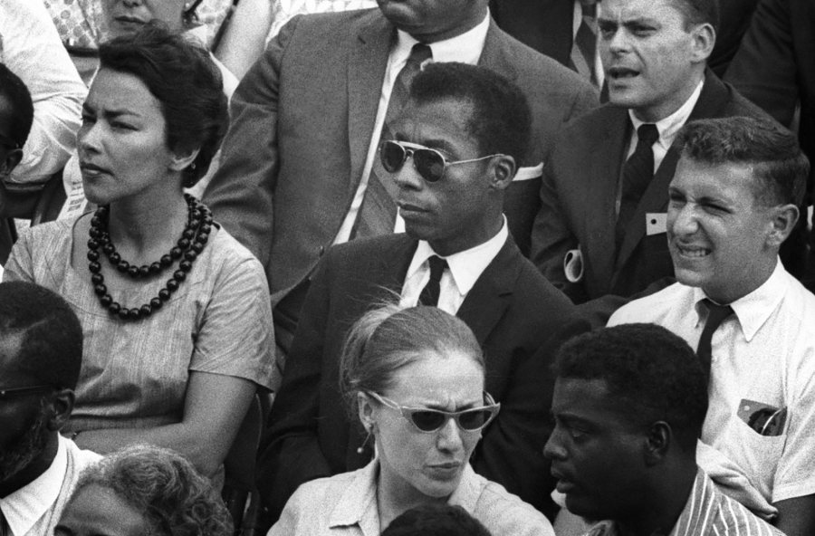 Author James Baldwin, at center, is shown in a still image from the film <em>I Am Not Your Negro</em>.