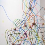 Eric Hongisto, untitled (theory of Tumbleweeds) 2004, Acrylic and yarn balls, 132 x 200 x 3 inches