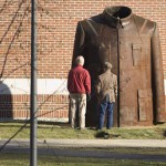 Standing together in front of the sculpture, Professor Grafflin and Anthony Shostak, the museum's education coordinator, provide a sense of the jacket's size.