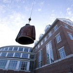 After the crane is repositioned closer to Alumni Walk, the sculpture is hoisted again.