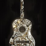 Cynthia Litwer, Reflections of Jazz, n.d., Acoustic guitar sculpture, stained glass, and mirrors, Loan from American Jazz Museum, Kansas City, MO