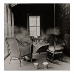 Claire Seidl (American, born 1952) Porch Dinner, 2014, gelatin silver print. Gift of Andres A. Verzosa, and David G. Whaples, 2014.