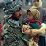 Peter Turnley, Kurdish Refugees, Gulf War, Southern Turkey, 1991, Archival Pigment Print, 24 x 20 inches, Bates College Museum of Art, Gift of the Olson Family