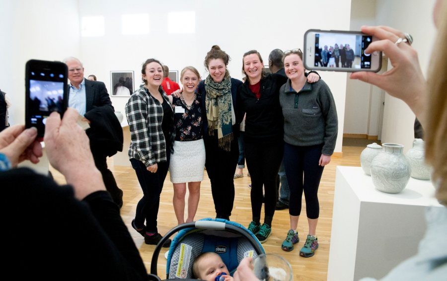 "The 2016 Senior Thesis Exhibition and reception at the Bates College Museum of Art is filled with beautiful work and excited visitors The artists will be there to greet you! ""Someone came in here and looked at our stuff and said 'you guys are really vibing off of each other.'""-- Sasha Lennon '16 of Cape Elizabeth, a double major in studio art and psychology (left) and Natalie Silver '16 of Bennington, Vt., a double major in studio art and history, throw pots for the Annual Senior Exhibition in their ground-floor Olin Arts studio. As co-coordinators of the Annual Entering Student Outdoor Program (along with classmate Jordan Cargill), they are close friends who share not only a studio but also an interest in the balance of form and function in their ceramic art. (Phyllis Graber Jensen/ Bates College)"