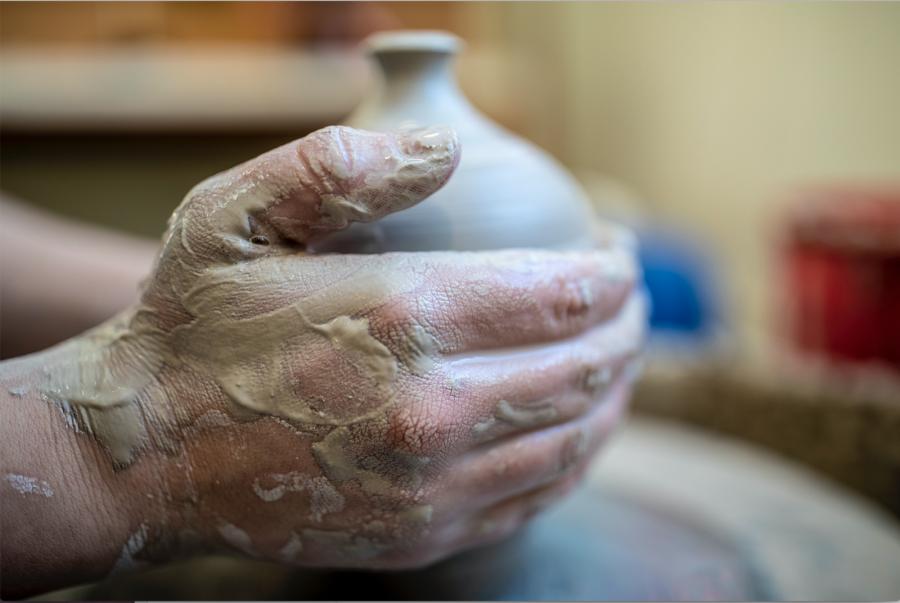 Celia Feal-Staub throwing a vessel, 2020, stoneware, photograph by Phyllis Graber Jensen