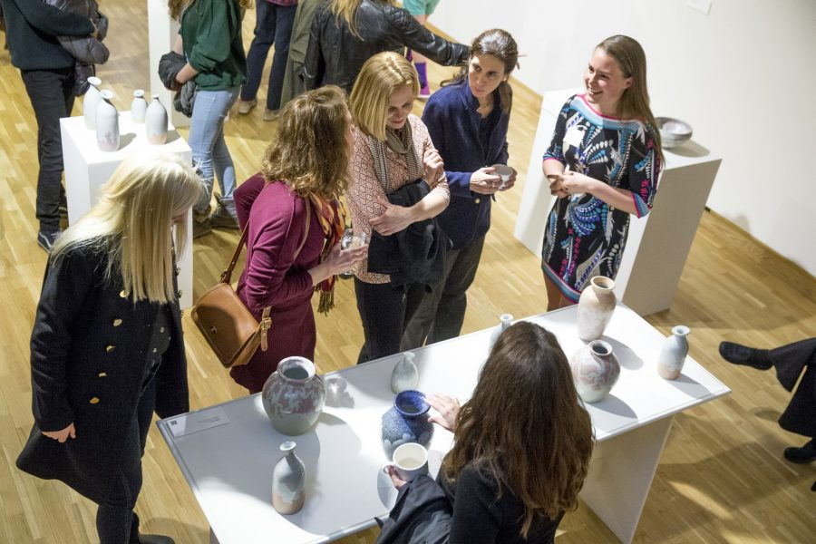 "The 2016 Senior Thesis Exhibition and reception at the Bates College Museum of Art is filled with beautiful work and excited visitors The artists will be there to greet you!   ""Someone came in here and looked at our stuff and said 'you guys are really vibing off of each other.'"" -- Sasha Lennon '16 of Cape Elizabeth, a double major in studio art and psychology (left) and Natalie Silver '16 of Bennington, Vt., a double major in studio art and history, throw pots for the Annual Senior Exhibition in their ground-floor Olin Arts studio. As co-coordinators of the Annual Entering Student Outdoor Program (along with classmate Jordan Cargill), they are close friends who share not only a studio but also an interest in the balance of form and function in their ceramic art. (Phyllis Graber Jensen/ Bates College)"