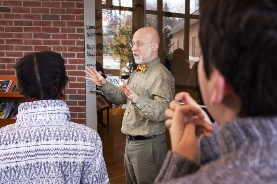 Anthony Shostak, education curator at the Bates Museum of Art, greets Lewiston middle Schoolers as they arrive on campus on February 5, 2020.