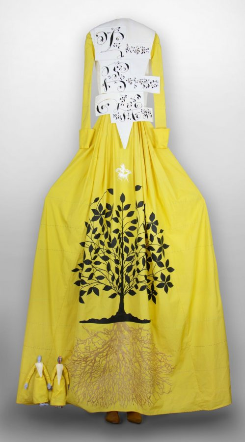 Lesley Dill, Mother Ann Lee, 2021, acrylic paint, hand-cut paper, thread on cotton fabric, wooden yoke and shoe lasts, 100 x 40 x 4 inches