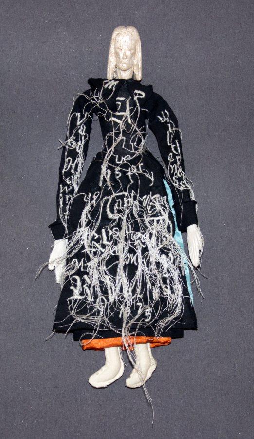 Lesley Dill, Mary Rowlandson: The History 1675, 2018, fabric, thread, balsa wood, 12 x 5.5 x 1 inches