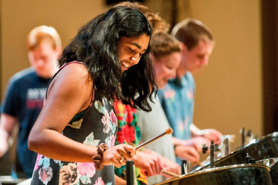 Zofia Ahmad '19 of Palo Alto, Calif. joins classmates for an encore at the Bates Steel Pan Orchestra concert.The Bates Steel Pan Orchestra, under the direction of Duncan Hardy, performs traditional West Indies arrangements in the Olin Concert Hall on Monday, Dec. 7th 2015.