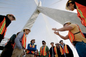 "Students enrolled in ""Study of the City"" visit Boston's Big Dig, stopping for a behind-the-scenes glimpse of the newly constructed Leonard P. Zakim Bunker Hill Bridge. (Phyllis Graber Jensen/Bates College)"