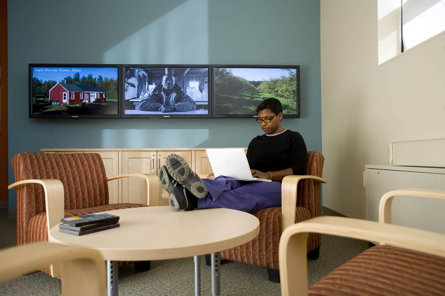 Views with a room: With a flatscreen video wall behind her, Jacqueline Smith '07 studies in the new Imaging Center. (Phyllis Graber Jensen/Bates College)