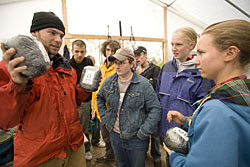 Biodiesel for Maine, Chewonki Foundation, Wiscasset  During Short Term, Associate Professor of Geology Beverly Johnson leads a group of students and staff to Chewonki to learn more about biodiesel fuel (vs. petro diesel). The presentation includes a PowerPoint session and a visit to the Chewonki facility that actually produces the fuel and powers Chewonki vehicles. Chewonki employees include:  Brendan Kober (red jacket, black cap), pathways to a sustainable future assistant  Chris Riley (red shirt) biodiesel production manager and equipment and logistics manager for Chewonki  Peter Arnold (gray pony tail), coordinator