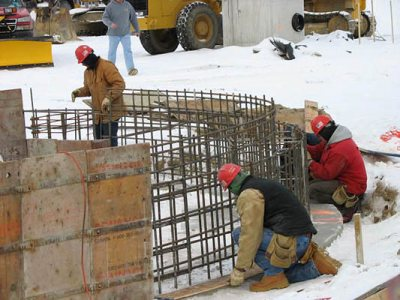 Hey baba rebar: On Jan. 16, workers prepared forms and rebar for the final section of the new dining Commons' concrete frost wall. The fireplace lounge will be situated here.