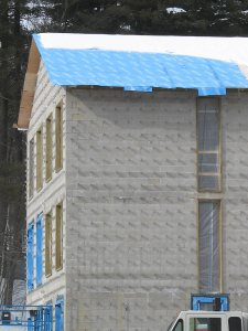 "Sandwich generation: ""Blueskin"" weather barrier forms a layer of the roofing ""sandwich"" on the new student housing. (Doug Hubley/Bates College)"