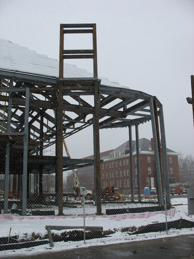 Commons' fireplace lounge, with a tall steel structure that will enclose the fireplace exhaust stack. (Doug Hubley/Bates College)