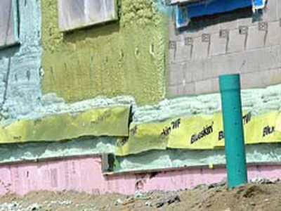 Colors of spring: The newly sprayed insulation on the new student housing is the green of Mint Julep candies, while the dried product is more of an acid green.