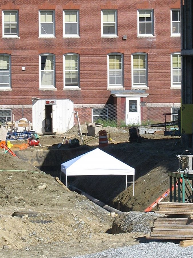 Complete with a tent to shield workers from the sun, this steam-line trench is south of Commons. (Doug Hubley/Bates College)