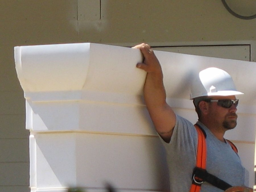 Steadying an end cap for the porch roof at 280 College. (Doug Hubley/Bates College)