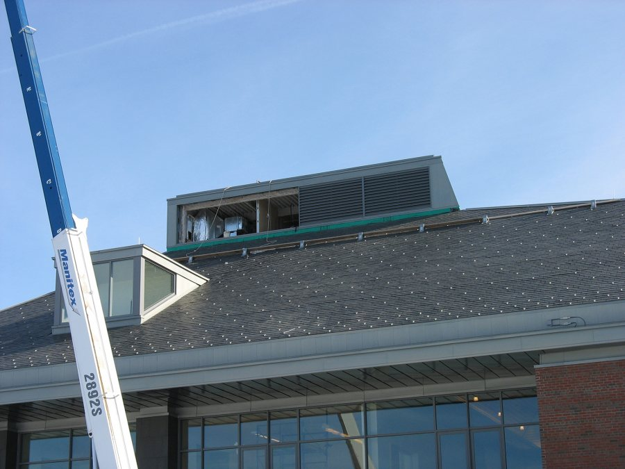 With two louvers in place on the new Commons' ventilation monitor, the crane has gone back for the next load. (Doug Hubley/Bates College)