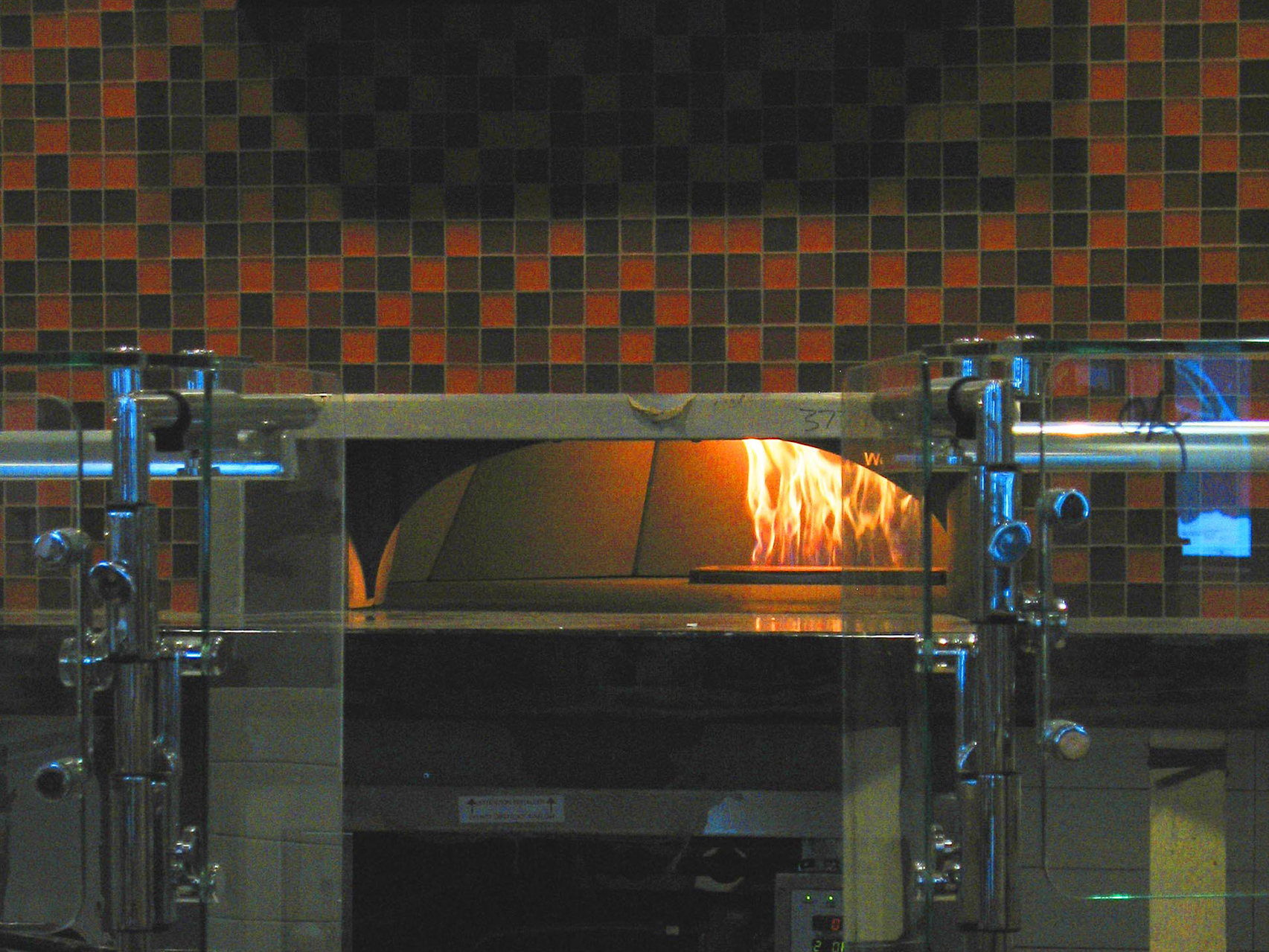 A test burn in the brick oven in the new Commons. (Doug Hubley/Bates College)