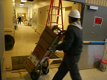 A Performance Food Group driver wheels a dolly's worth of food into the new Commons on Feb. 7, 2008. (Elizabeth Mitchell '10 for Bates College)