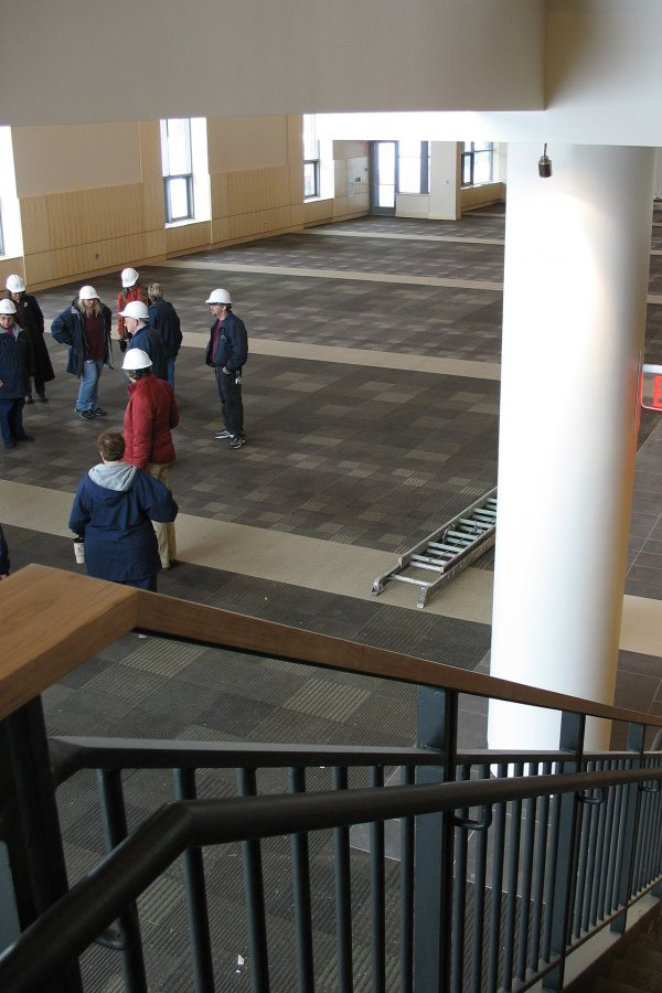 A staff-faculty tour group visits the main dining hall in the new Commons on Feb. 4. (Doug Hubley/Bates College)