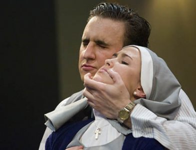 Stephen Lattanzi '08 as Angelo pressures Isabella, played by Marielle Vigneau-Britt  '10