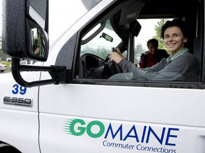 Julie Rosenbach, the former EPA official hired in 2006 to become Bates' first full-time environmental coordinator, at the wheel of the commuter van to Portland, departing from and arriving each day behind Alumni Gymnasium on Central Avenue.