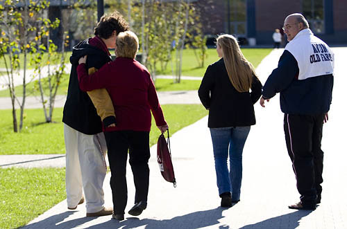 Parents & Family Weekend On his way to the locker room, Matt Conetta '12, an offensive lineman for the football team, walks down Alumni Walkway with motehr Carolyn, father Doug and sister Aimee, 21, a student at Fairfield University. The family is from Ridgewood, N.J.