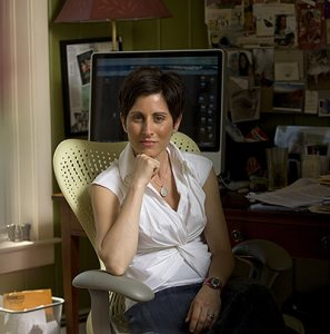 "Lisa Genova '92, author of ""Still Alice,"" a novel about a women with Alzheimer's, has a Harvard Ph.D. in neuroscience. She is posing at her home in Chatham, Mass., at 121 Countryside Drive."